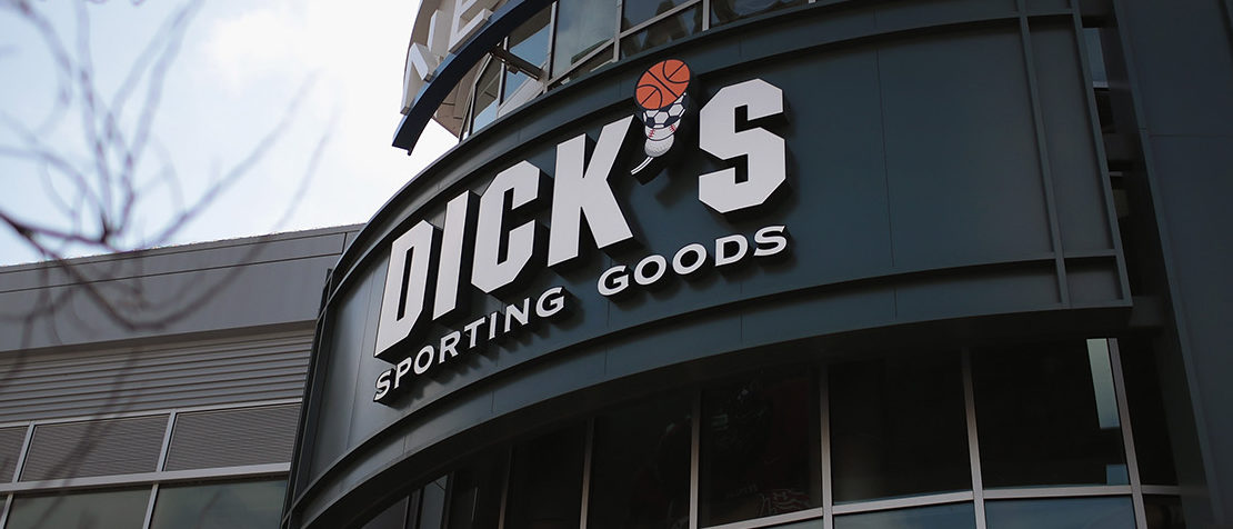 A sign hangs outside of a Dick's Sporting Goods store on February 28, 2018 in Chicago, Illinois. Citing the recent shooting at Stoneman Douglas School in Parkland, Florida, the sporting goods retailer announced today that it would no longer sell firearms to anyone under 21 years of age, no longer sell high capacity magazines, and would no longer sell assault-style rifles at any company owned stored.  (Photo by Scott Olson/Getty Images)