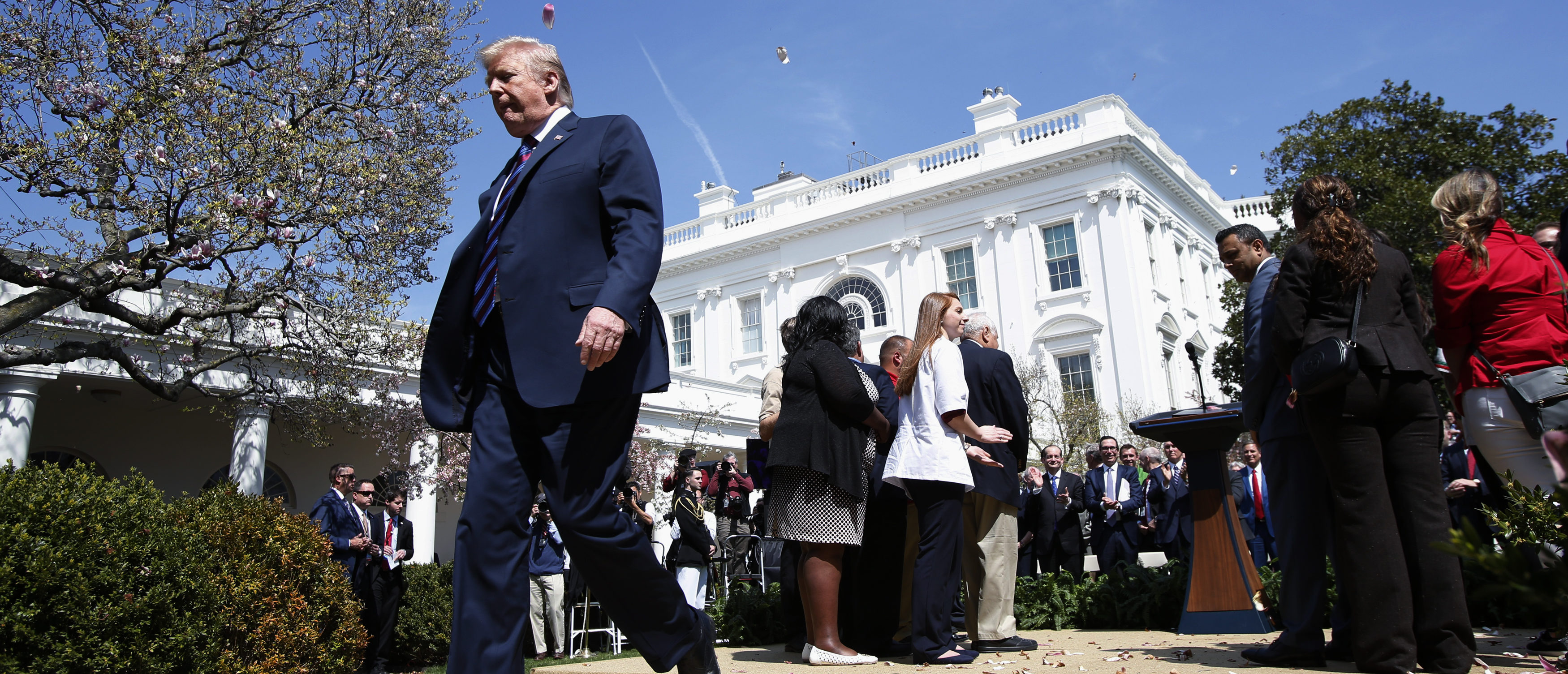 U.S. President Donald Trump departs after giving remarks on tax cuts for American workers during an event in the White House Rose Garden in Washington, U.S., April 12, 2018. REUTERS/Kevin Lamarque - HP1EE4C1FK5C8