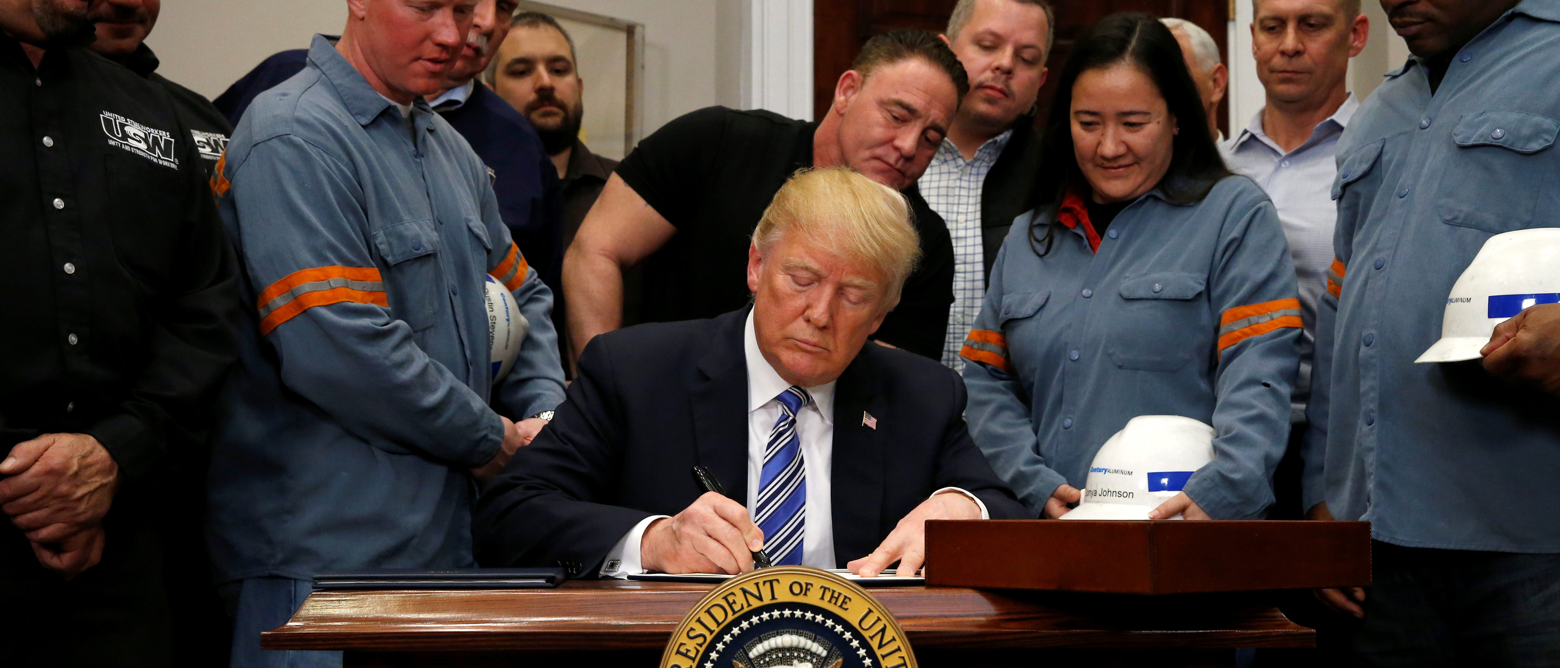 U.S. President Donald Trump signs a presidential proclamation placing tariffs on steel and aluminum imports while surrounded by workers from the steel and aluminum industries at the White House in Washington, U.S. March 8, 2018. REUTERS/Leah Millis | West Virginia Asks EPA To Save Steel