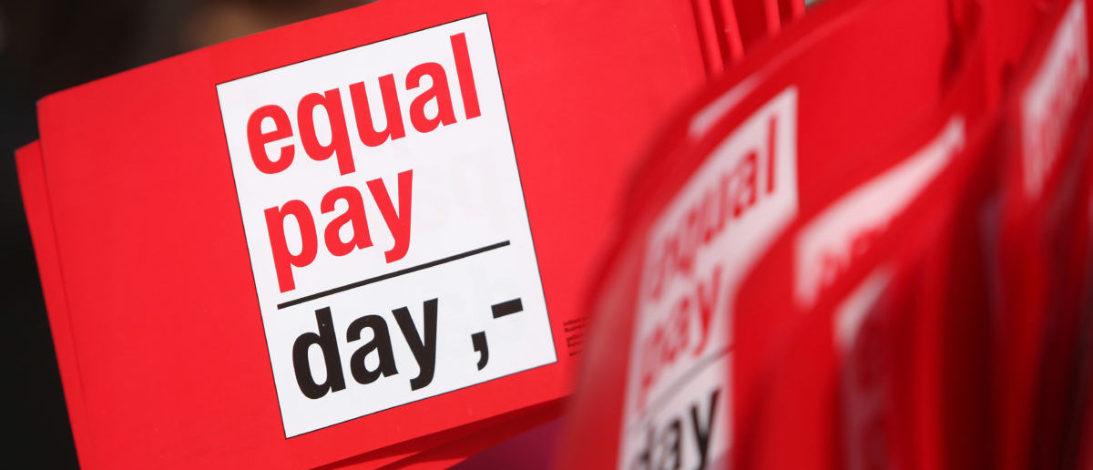 Flags reading 'Equal Pay Day' are seen during the 'Equal Pay Day' demonstration on March 21, 2014 in Berlin, Germany. (Adam Berry/Getty Images)