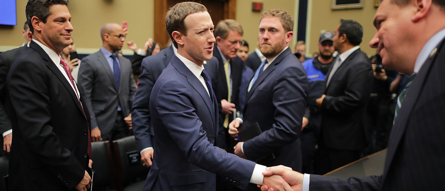 WASHINGTON, DC - APRIL 11: Facebook co-founder, Chairman and CEO Mark Zuckerberg (L) shakes hands with House Energy and Commerce Committee member Rep. Richard Hudson (R-NC) at the conclusion of a hearing in the Rayburn House Office Building on Capitol Hill April 11, 2018 in Washington, DC. (Photo by Chip Somodevilla/Getty Images) | Facebook Accuses Google, Twitter, Amazon | Facebook Seeks Conservatives' Policy Help