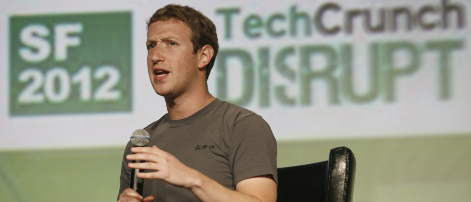 "Facebook founder and CEO Mark Zuckerberg speaks at the TechCrunch Disrupt SF 2012 conference on September 11, 2012 in San Francisco, in his first public interview since the massive public offering on May 18 that was hotly anticipated but ended up being a flop. Facebook is not building its own mobile phone, despite some reports to the contrary, Zuckerberg said, adding the phone would be ""clearly the wrong strategy"" to adopt.    (Photo: KIMIHIRO HOSHINO/AFP/GettyImages)"