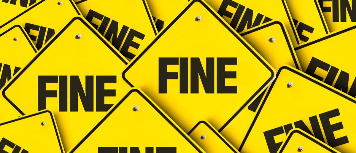 """Pile of signs with """"Fine"""" on them. (Shutterstock/Gustavo Frazao) 