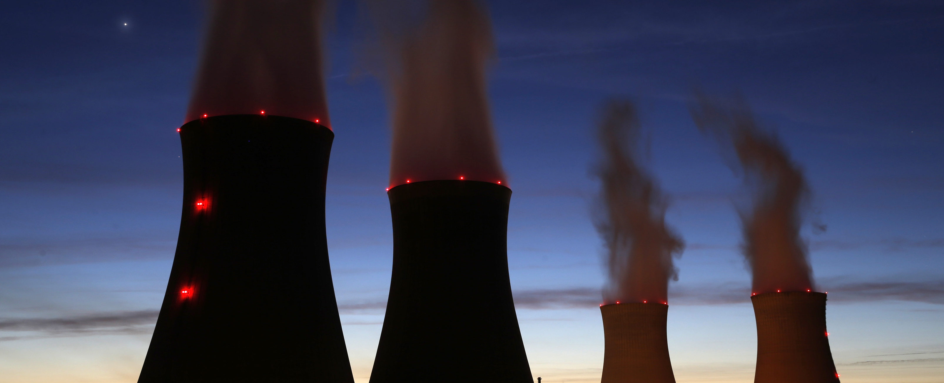 Steam rises at night from the cooling towers of the Electricite de France (EDF) nuclear power station in Dampierre-en-Burly, March 8, 2015. Picture taken March 8, 2015. REUTERS/Christian Hartmann