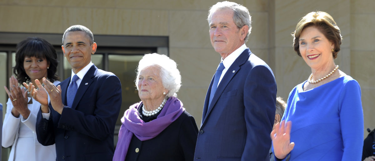 (L-R) US First Lady Michelle Obama, US President Barack Obama, former First Lady Barbara Bush, former US President George H.W. Bush(hidden), former US President George W. Bush and Laura Bush stand on stage during the George W. Bush Presidential Center dedication ceremony in Dallas, Texas, on April 25, 2013. AFP PHOTO/Jewel Samad (Photo credit should read JEWEL SAMAD/AFP/Getty Images)