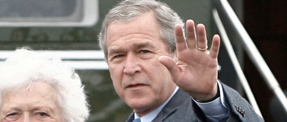 FILE PHOTO: U.S. President George W. Bush (R) waves alongside his parents, former President George Bush and former first lady Barbara Bush upon their arrival Fort Hood, Texas, April 8, 2007. Bush and his family arrived at the Army Base to attend Easter Sunday church service before returning to his ranch in Crawford. REUTERS/Jason Reed /File Photo
