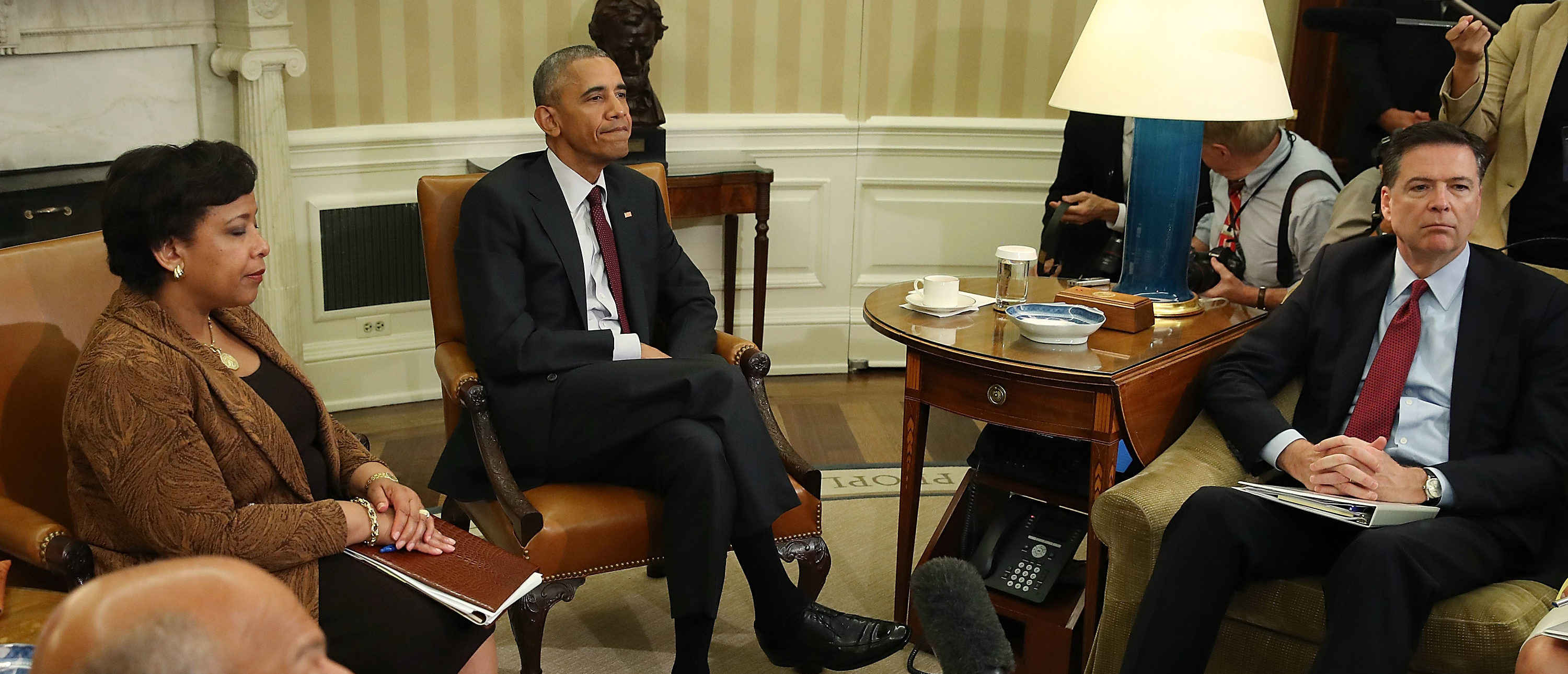 WASHINGTON, DC - JULY 19:  U.S. President Barack Obama (C) speaks to the media after meeting with Attorney General Loretta Lynch (L) and FBI Director James Comey in the Oval Office at the White House July 19, 2016 in Washington, DC. The president was briefed  following the July 7 sniper killings of five Dallas police officers working a protest and Sunday's killing of three police officers in Baton Rouge, Louisiana.  (Photo by Mark Wilson/Getty Images)