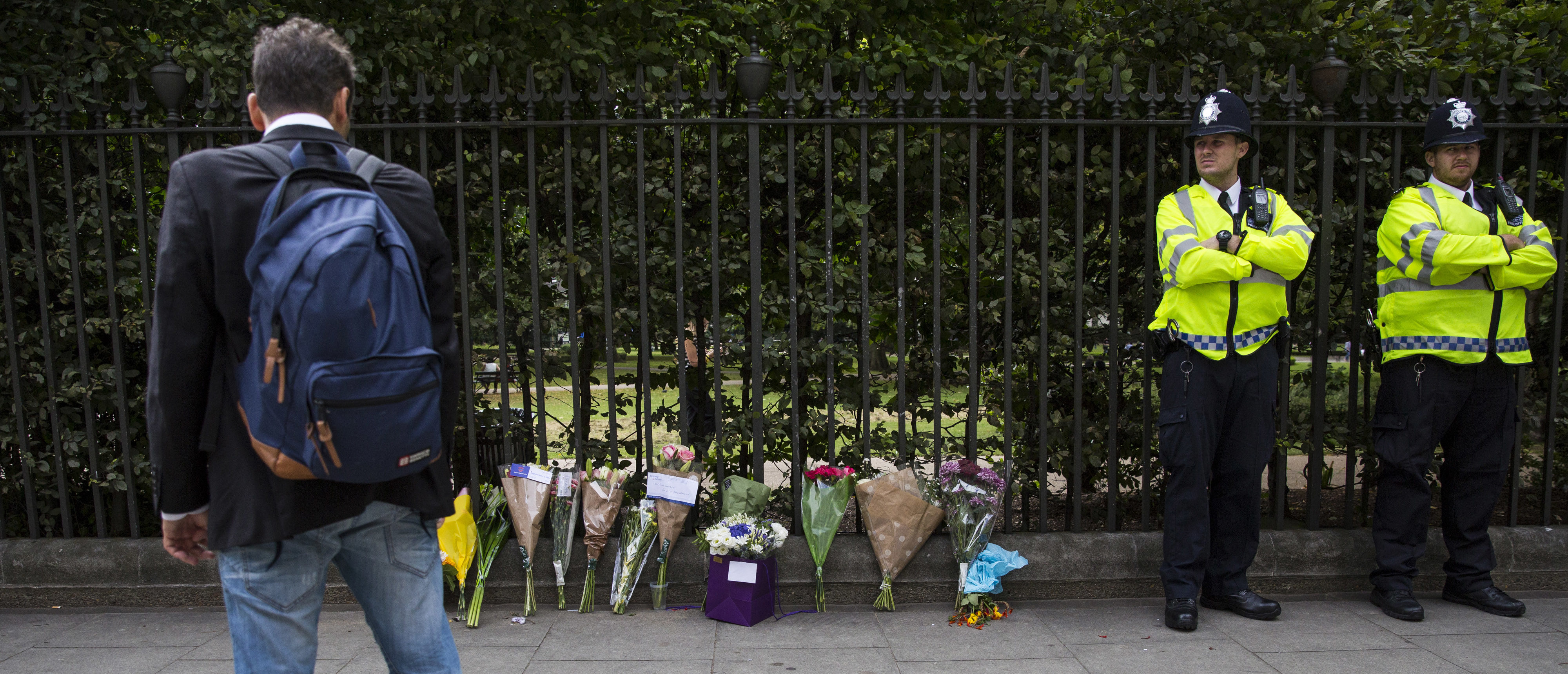 LONDON, ENGLAND - AUGUST 04: Police officers stand guard by flowers left at the scene of a knife attack in Russell Square on August 4, 2016 in London, England. Six people were attacked by a 19 year old man with a knife at 10.30pm in Russell Square, London last night. A woman died of her injuries. The suspect was arrested at the scene and is being held at a London Hospital. Police say mental health issues are a significant factor. (Photo by Jack Taylor/Getty Images)
