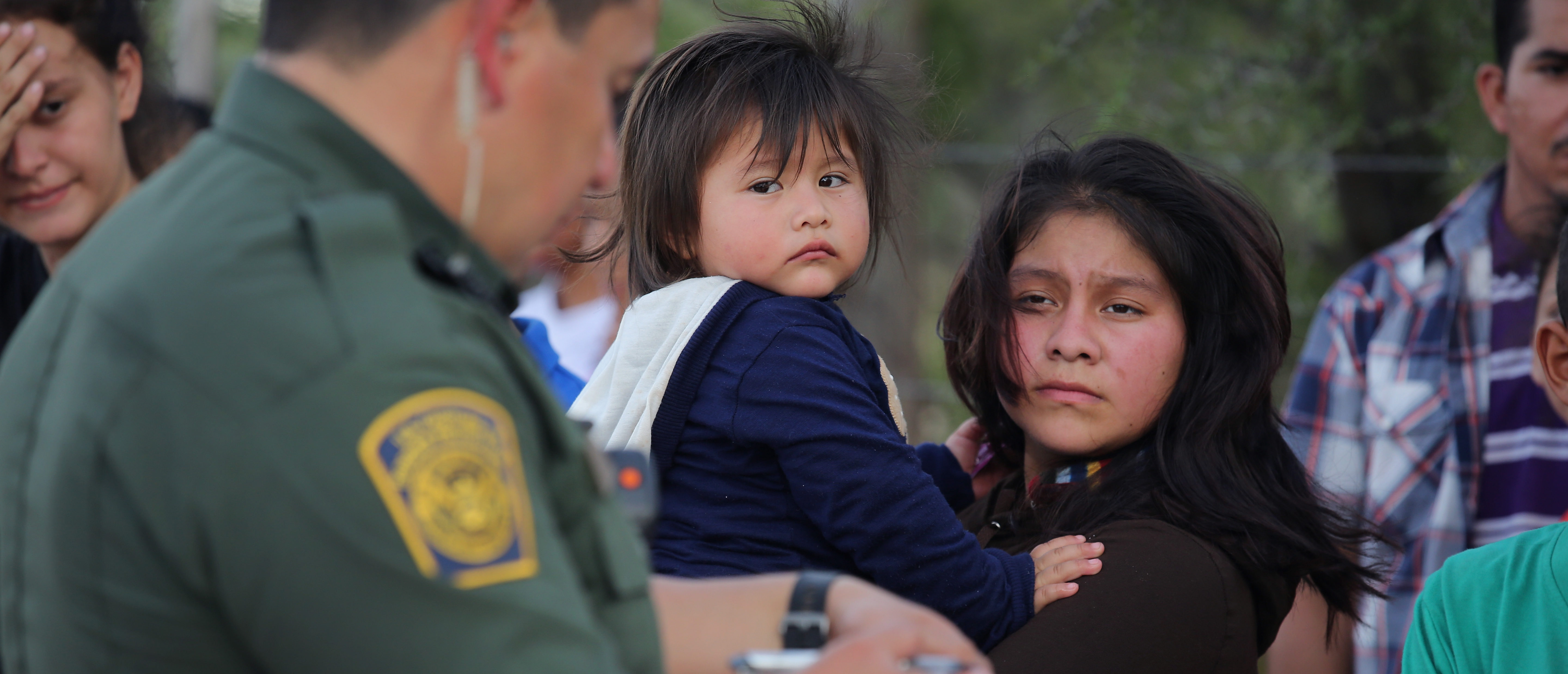 ROMA, TX - AUGUST 17: U.S. Border Patrol agents process immigrants from Central America while taking them into custody on August 17, 2016 near Roma, Texas. Thousands of Central American families continue to cross the Rio Grande at the Texas-Mexico border, seeking asylum in the United States. Border security has become a major issue in the U.S. Presidential campaign. (Photo by John Moore/Getty Images)
