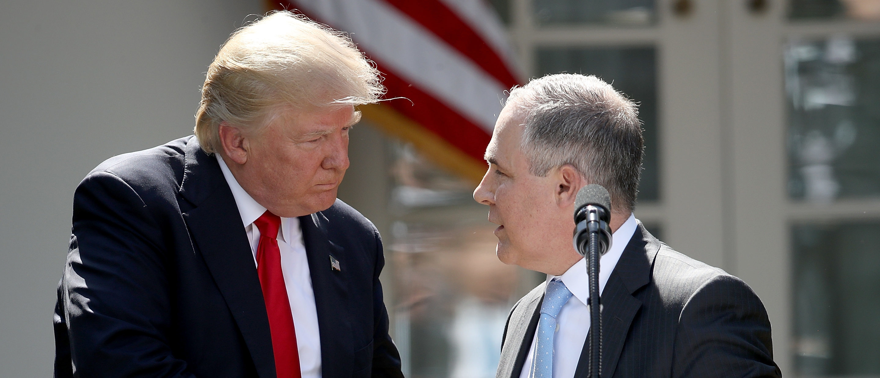 WASHINGTON, DC - JUNE 01: U.S. President Donald Trump shakes hands with EPA Administrator Scott Pruitt after announcing his decision for the United States to pull out of the Paris climate agreement in the Rose Garden at the White House June 1, 2017 in Washington, DC. Trump pledged on the campaign trail to withdraw from the accord, which former President Barack Obama and the leaders of 194 other countries signed in 2015. The agreement is intended to encourage the reduction of greenhouse gas emissions in an effort to limit global warming to a manageable level. (Photo by Win McNamee/Getty Images)