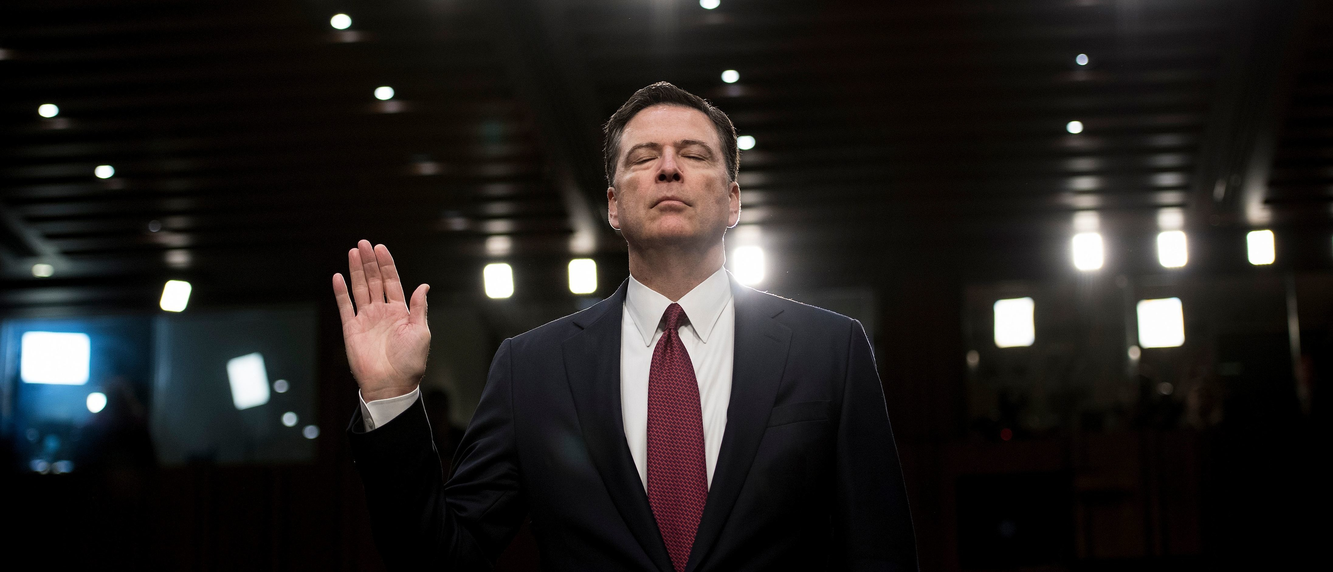 Ousted FBI director James Comey is sworn in during a hearing before the Senate Select Committee on Intelligence on Capitol Hill June 8, 2017 in Washington, DC.