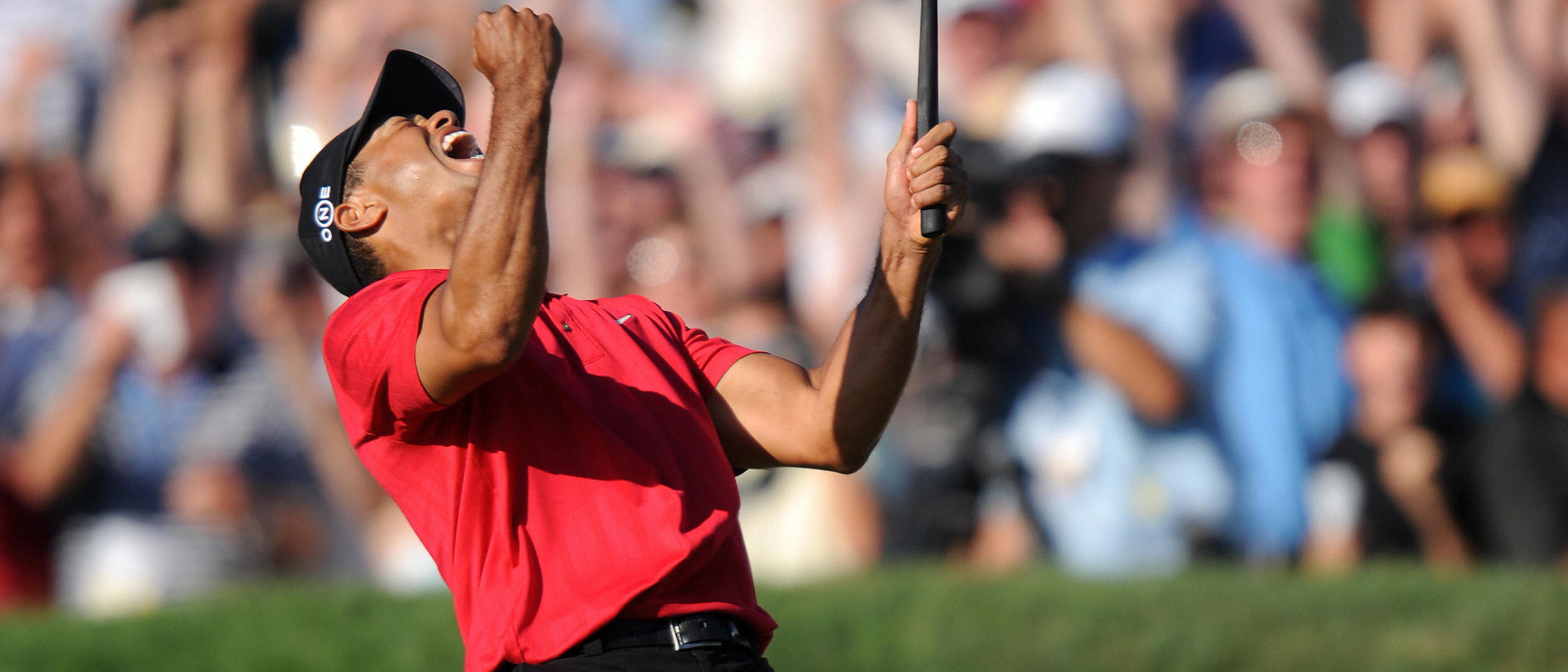 Tiger Woods of the US celebrates his birdie putt on the 18th hole in the fourth round of the 108th U.S. Open golf tournament forcing a playoff with compatriot Rocco Mediate at Torrey Pines Golf Course in San Diego, California on June 15, 2008. (Photo: ROBYN BECK/AFP/Getty Images)