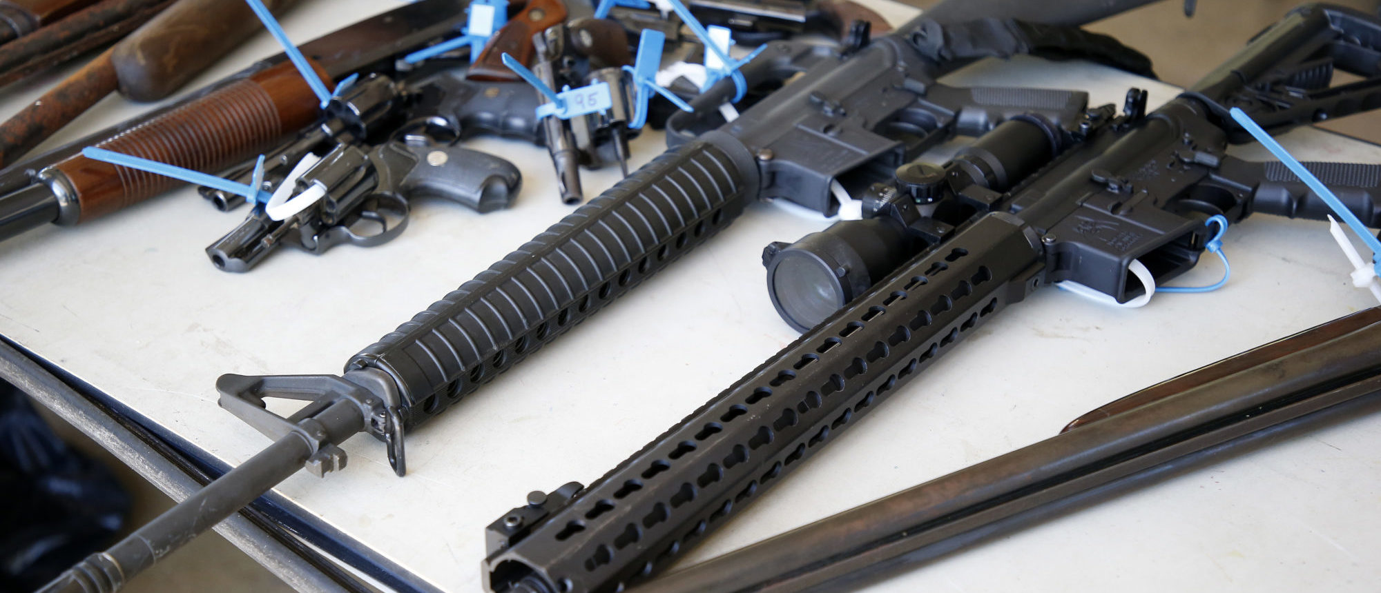 Two AR-15 rifles, along with other assorted guns, sit on a table after being surrendered during a City of Miami gun buy-back event in Miami, Florida on March 17, 2018. (Photo: RHONA WISE/AFP/Getty Images)