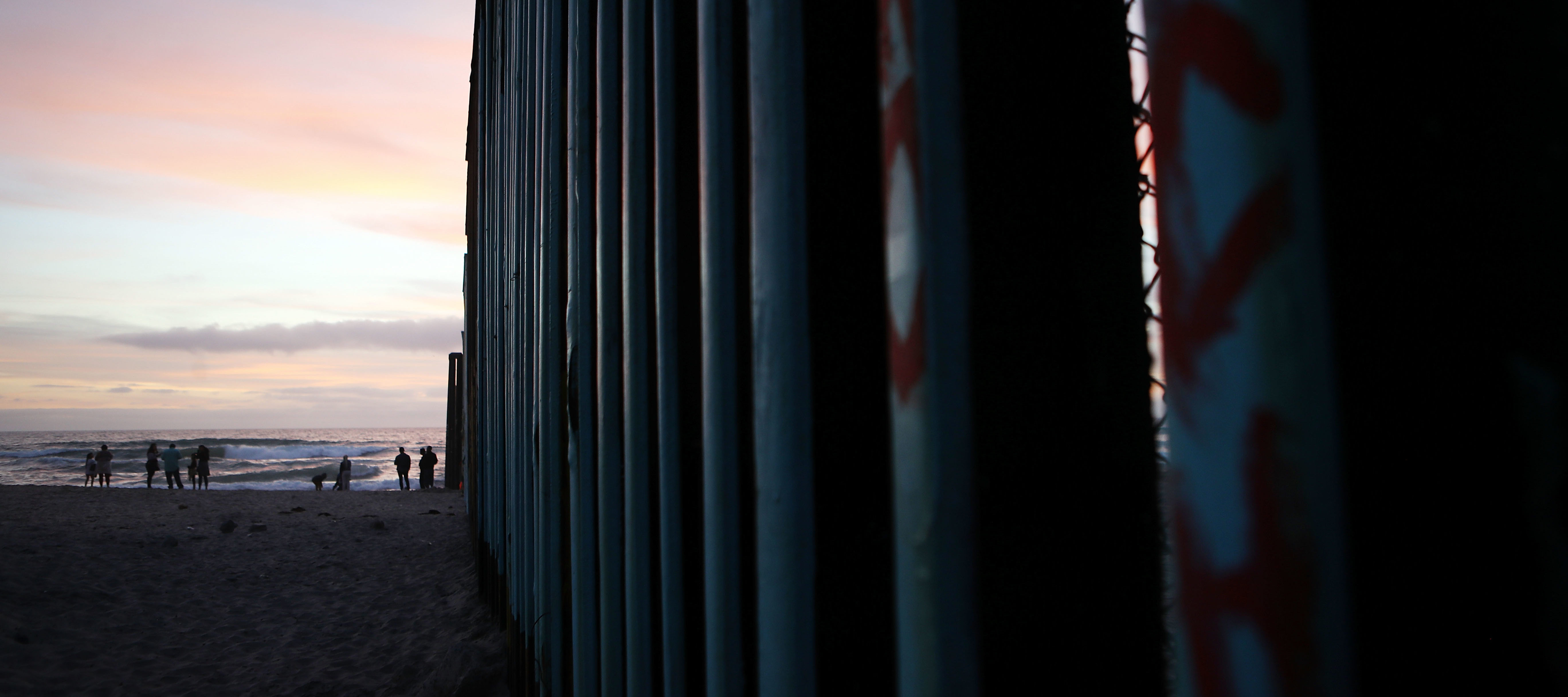 TIJUANA, MEXICO - APRIL 06: People gather on the beach along the U.S.-Mexico border fence (R) on April 6, 2018 in Tijuana, Mexico. President Trump has issued a decree for the National Guard to guard the 3,200 kilometer border between the United States and Mexico. (Photo by Mario Tama/Getty Images)