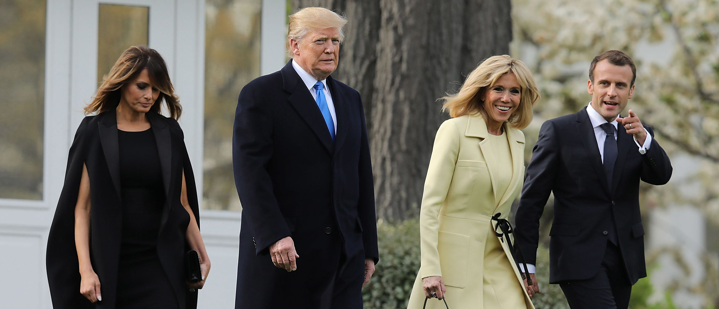 WASHINGTON, DC - APRIL 23: (L-R) U.S. first lady Melania Trump, U.S President Donald Trump, Brigitte Macron and French President Emmanuel Macron walk across the South Lawn before participating in a tree-planting ceremony at the White House April 23, 2018 in Washington, DC. Trump is hosting Macron for a two day offical visit that will include dinner at George Washington's Mount Vernon, a tree planting on the White House South Lawn and a joint news conference. (Photo by Chip Somodevilla/Getty Images)