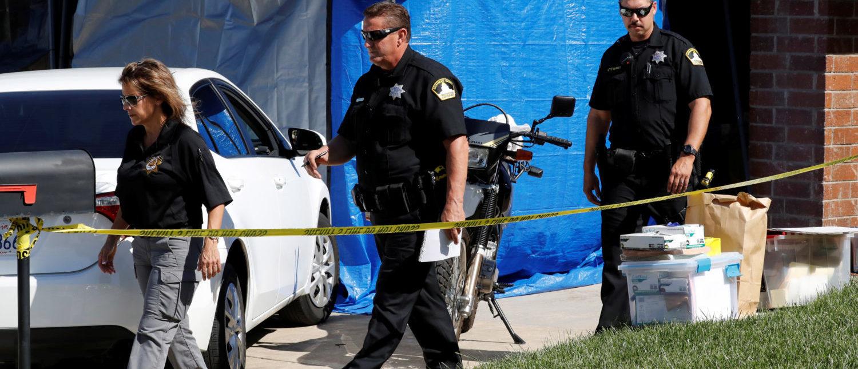 Investigators walk out of the garage belonging to Joseph James Deangelo, who was arrested for the East Area Rapist/Original Night Stalker/Golden State Killer case in Citrus Heights, California, U.S., April 25, 2018. REUTERS/Fred Greaves