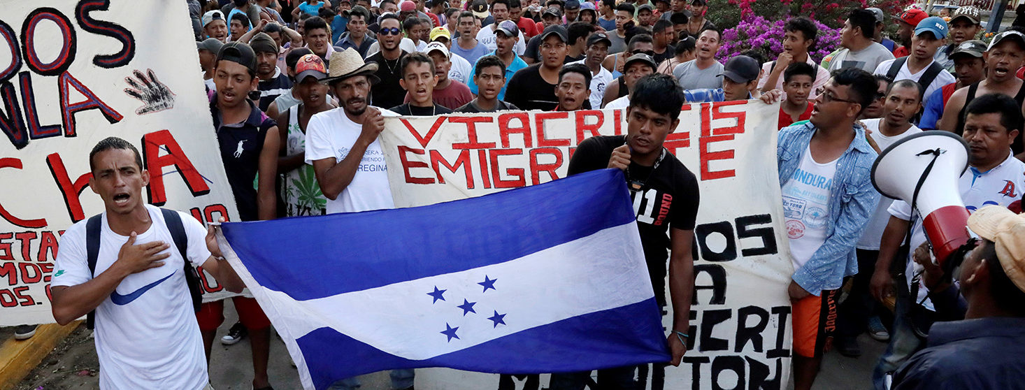 Honduran migrants hold their national flag during a march along a street in the city as they take a pause from traveling in their caravan, during their journey to the U.S., in Matias Romero, Mexico April 3, 2018. REUTERS/Henry Romero