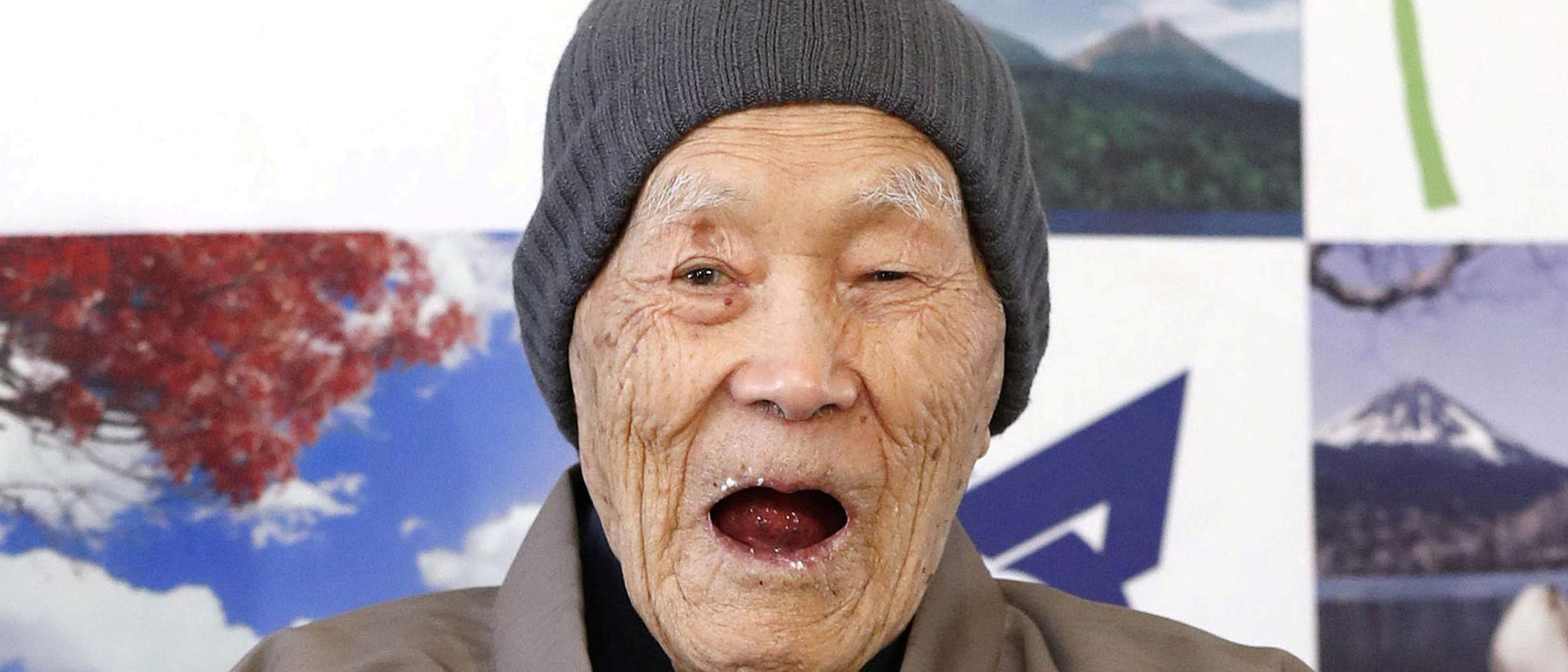 Japanese Masazo Nonaka, who was born 112 years and 259 days ago, eats his favorite cake as he receives a Guinness World Records certificate naming him the world's oldest man during a ceremony in Ashoro, on Japan's northern island of Hokkaido, in this photo taken by Kyodo April 10, 2018.   Mandatory credit Kyodo/via REUTERS