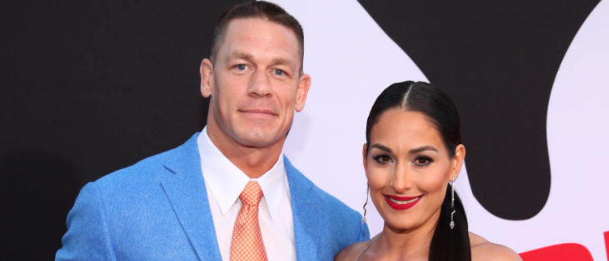 """WESTWOOD, CA - APRIL 03:  John Cena (L) and Nikki Bella attend the premiere of Universal Pictures' """"Blockers"""" at Regency Village Theatre on April 3, 2018 in Westwood, California.  (Photo by Christopher Polk/Getty Images)"""