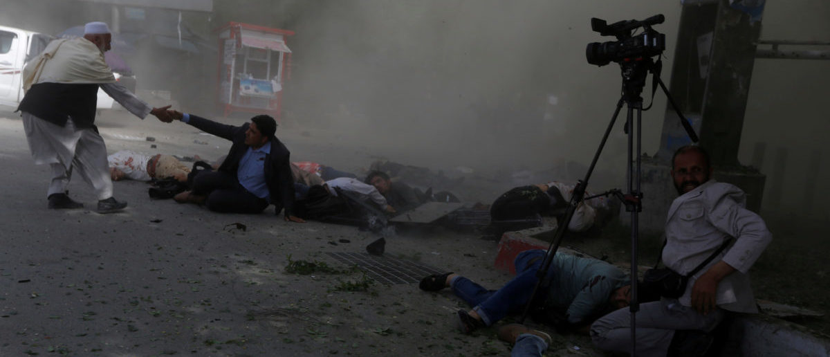 Afghan journalists are seen after a second blast in Kabul, Afghanistan April 30, 2018. REUTERS/Omar Sobhani