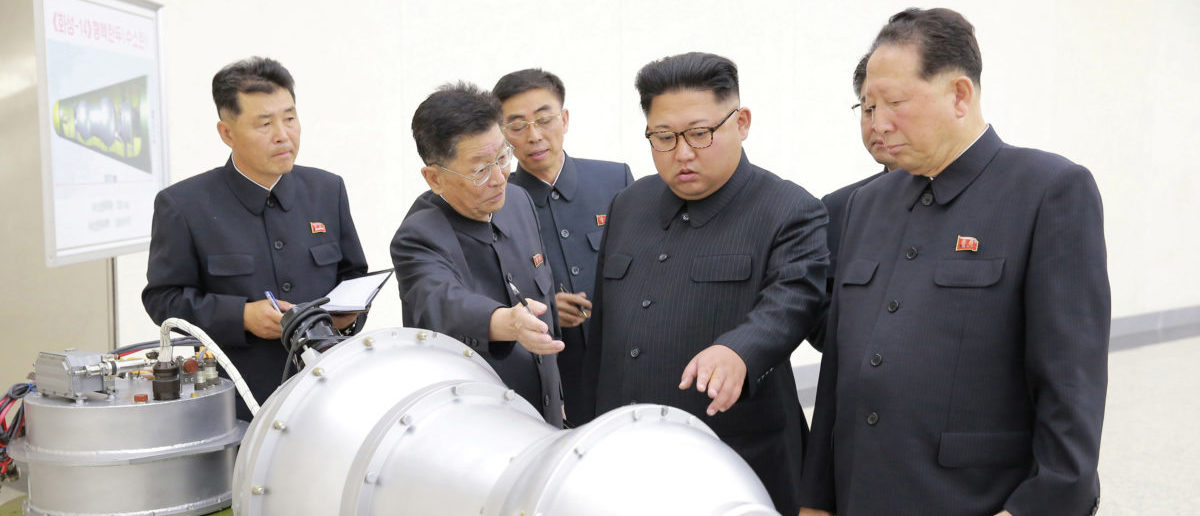 North Korean leader Kim Jong Un provides guidance with Ri Hong Sop (2nd L) and Hong Sung Mu (R) on a nuclear weapons program in this undated photo released by North Korea's Korean Central News Agency (KCNA) in Pyongyang September 3, 2017. KCNA via REUTERS