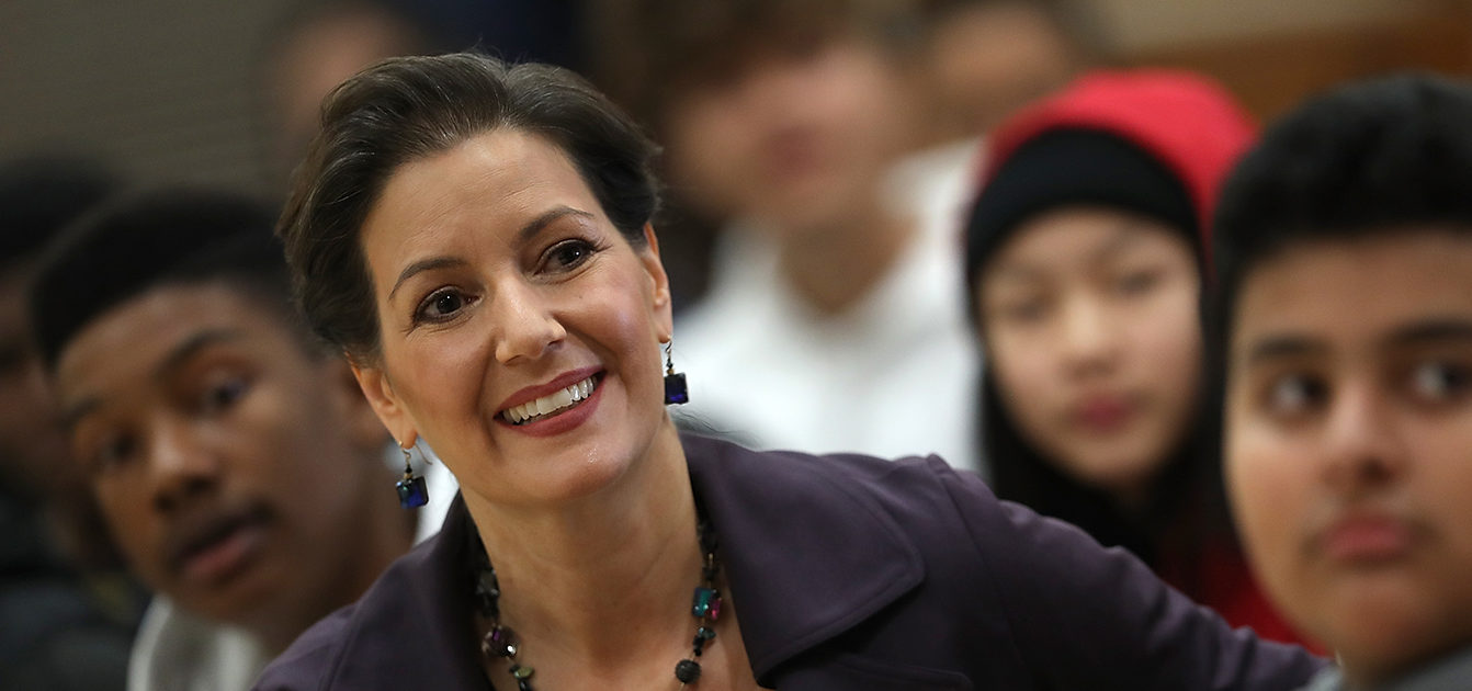 Oakland mayor Libby Schaaf looks on during an assembly at Edna Brewer Middle School about the U.S. Constitution on January 19, 2018 in Oakland, California. Oakland mayor Libby Schaaf discussed the U.S. Constitution with middle schoolers a day after she said she would be willing to go to jail to defend Oakland's sanctuary city policy following rumors that Immigration and Customs Enforcement (ICE) agents would be conducting raids and arresting up to 1,500 undocumented immigrants in Northern California. (Photo by Justin Sullivan/Getty Images) | DOJ Demands Schaaf Prove Law Compliance