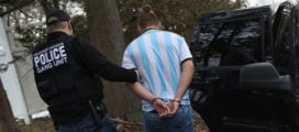 Homeland Security Investigations (HSI) ICE agents detain a suspected MS-13 gang member and Honduran immigrant at his home on March 29, 2018 in Brentwood, New York. Overnight and into the morning, U.S. federal agents and local police detained suspected gang members across Long Island in a surge of arrests. The actions were part of Operation Matador, a nearly year-long anti-gang effort targeting transnational gangs, with an emphasis on MS-13. (Photo by John Moore/Getty Images)