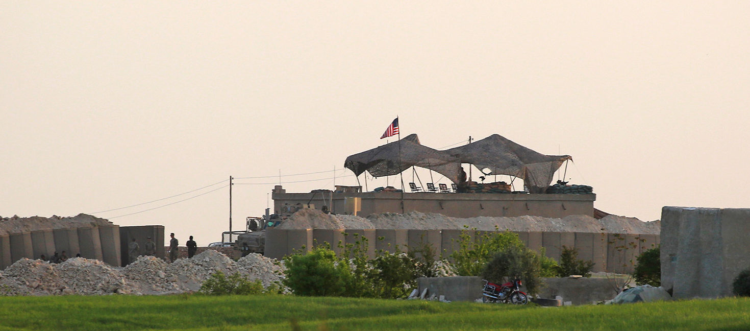 The Syrian Observatory for Human Rights, a Britain-based monitor with sources on the ground, says around 350 members of the US-led coalition -- mostly American troops -- are stationed around Manbij. DELIL SOULEIMAN/AFP/Getty Images | US In Syria But Trump Wants 'Rapid End'
