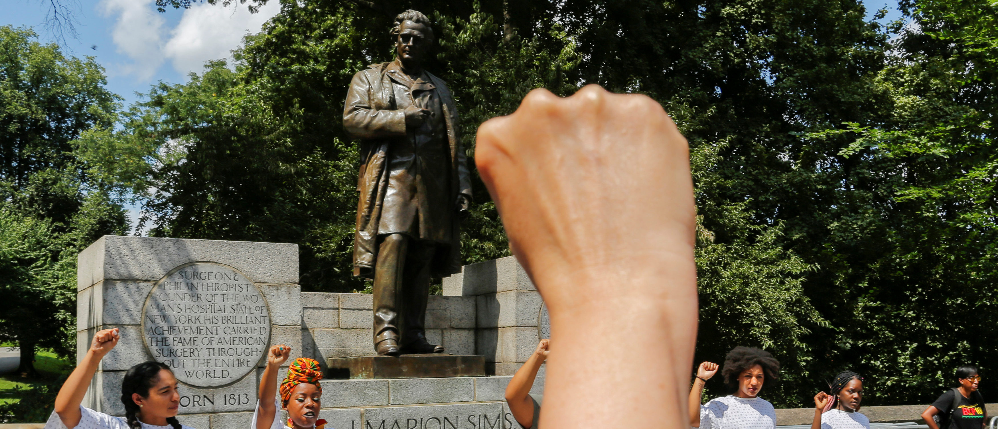 People take part in protest against white supremacy in front of J. Marion Sims statue at the upper east side in New York, August 19, 2017. REUTERS/Eduardo Munoz