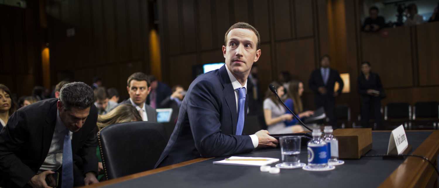 WASHINGTON, DC - APRIL 10: Facebook co-founder, Chairman and CEO Mark Zuckerberg testifies before a combined Senate Judiciary and Commerce committee hearing in the Hart Senate Office Building on Capitol Hill April 10, 2018 in Washington, DC. Zuckerberg, 33, was called to testify after it was reported that 87 million Facebook users had their personal information harvested by Cambridge Analytica, a British political consulting firm linked to the Trump campaign. [Photo by Zach Gibson/Getty Images]
