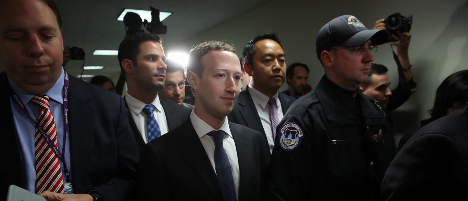 WASHINGTON, DC - APRIL 09:  Facebook CEO Mark Zuckerberg (C) leaves the office of Sen. Dianne Feinstein (D-CA) after meeting with Feinstein on Capitol Hill on April 9, 2018 in Washington, DC. Zuckerberg is meeting with individual senators in advance of tomorrow's scheduled hearing before the Senate Judiciary and Commerce committeees. Zuckerberg is under pressure to explain why tens of millions of Facebook user's private information was shared with Cambridge Analytica. (Photo by Win McNamee/Getty Images)