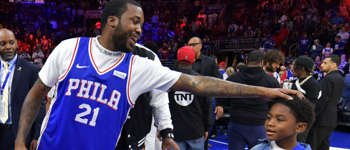Entertainer Meek Mill stands with his son Papi at halftime during the game between the Miami Heat and Philadelphia 76ers at Wells Fargo Center on April 24, 2018 in Philadelphia, Pennsylvania. (Photo by Drew Hallowell/Getty Images)