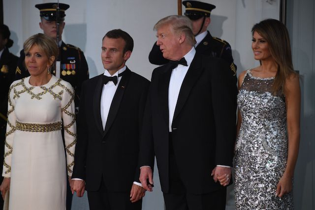 US President Donald Trump and First Lady Melania Trump welcome French President Emmanuel Macron and his wife, Brigitte Macron, as they arrive for a State Dinner at the North Portico of the White House in Washington, DC, April 24, 2018. (Photo by JIM WATSON / AFP) (Photo credit should read JIM WATSON/AFP/Getty Images)