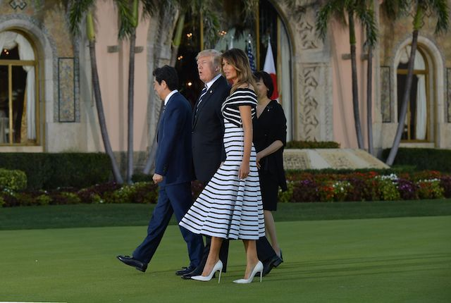 US President Donald Trump and First Lady Melania Trump greet Japan's Prime Minister Shinzo Abe and wife Akie Abe as they arrive for dinner at Trump's Mar-a-Lago resort in Palm Beach, Florida on April 17, 2018. / AFP PHOTO / MANDEL NGAN (Photo credit should read MANDEL NGAN/AFP/Getty Images)