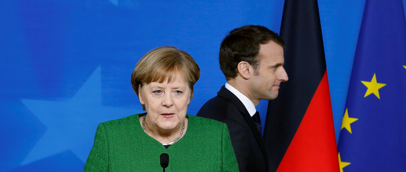 German Chancellor Angela Merkel and France's President Emmanuel Macron hold joint news conference at a  European Union leaders summit in Brussels, Belgium, March 23, 2018. REUTERS/Francois Lenoir/File Photo