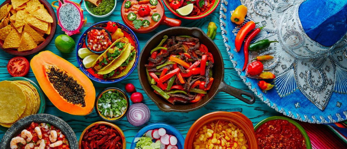 Mexican food mix colorful background Mexico and sombrero Shutterstock/Tono Balaguer | Woman Does Decolonizing Diet