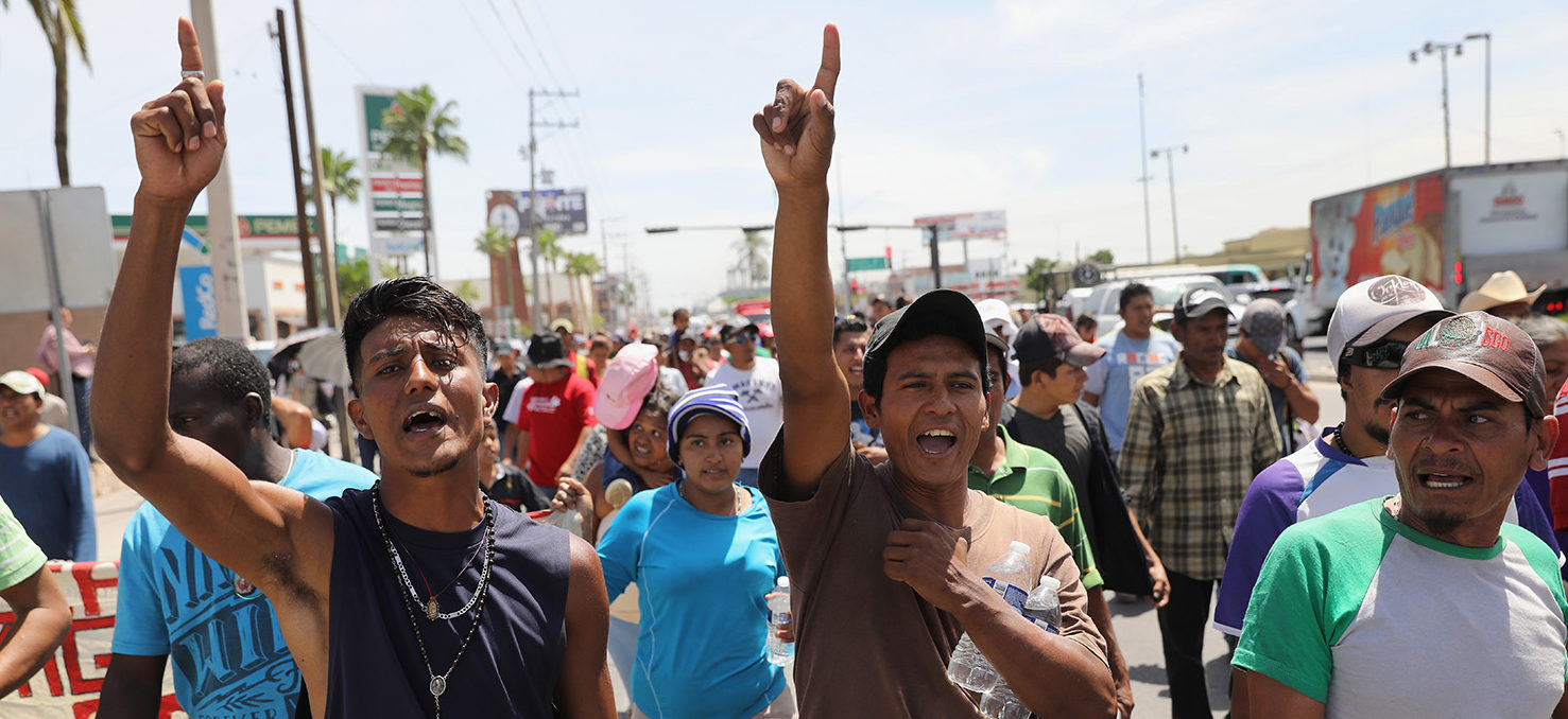 """Central American immigrants, part of an immigrant """"caravan,"""" march in protest against U.S. President Donald Trump on April 23, 2018 in Hermosillo, Mexico. They demonstrated against Trump's morning tweets calling for U.S. Homeland Security to stop them from crossing the border into the United States to request political asylum. More than 500 immigrants, the remnants of a caravan of Central Americans that began their journey north almost a month ago, is within days of reaching their destination in Tijuana, which borders San Diego. Traveling together, many atop freight trains known as the """"beast,"""" or in buses, they have sought safety in numbers on the dangerous journey. Along the way, they have received an outpouring of help from local charities, the Mexican Red Cross, private citizens and government officials. President Trump sent National Guard troops to U.S. border regions in response to the caravan weeks before, although many in the group are families who plan to seek political asylum the U.S. (Photo by John Moore/Getty Images) 