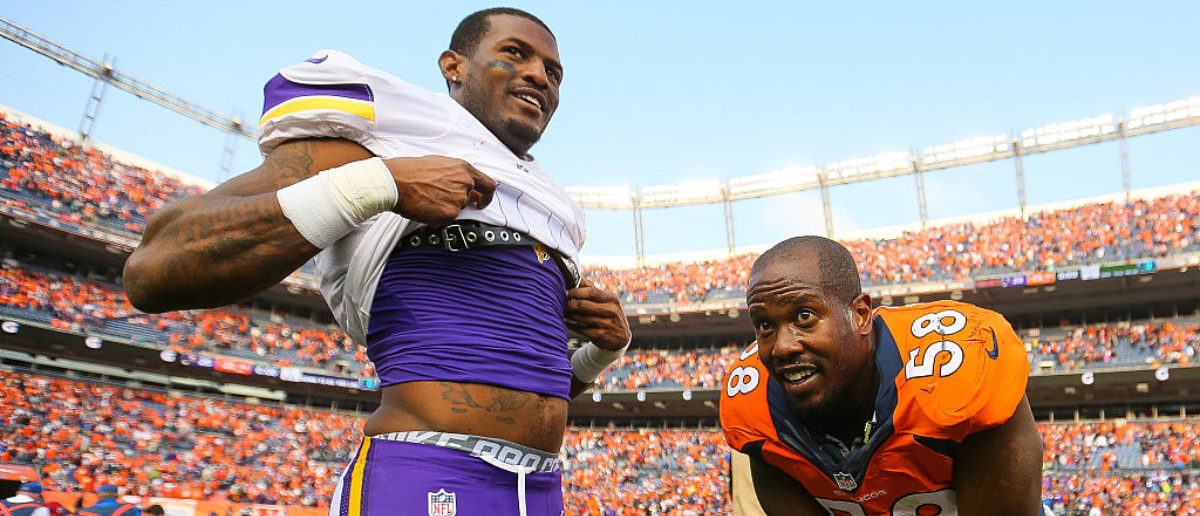 DENVER, CO - OCTOBER 4: Wide receiver Mike Wallace #11 of the Minnesota Vikings and outside linebacker Von Miller #58 of the Denver Broncos meet at midfield before exchanging jerseys after the Denver Broncos 23-20 win over the Minnesota Vikings at Sports Authority Field at Mile High on October 4, 2015 in Denver, Colorado. (Photo by Justin Edmonds/Getty Images)