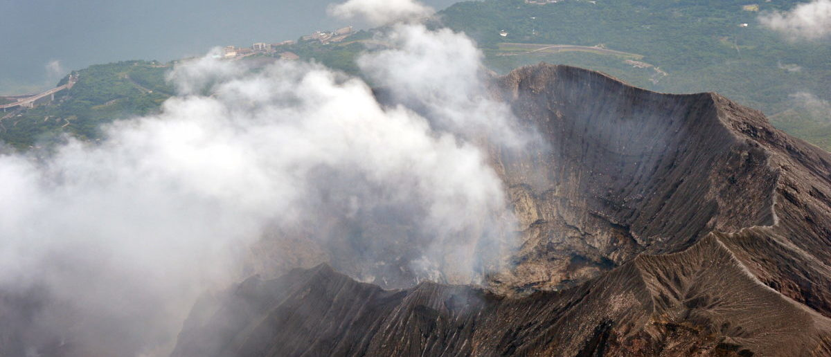 An aerial view shows the crater atop Mt. Sakurajima in Kagoshima, southwestern Japan, in this photo taken by Kyodo August 15, 2015. REUTERS/Kyodo