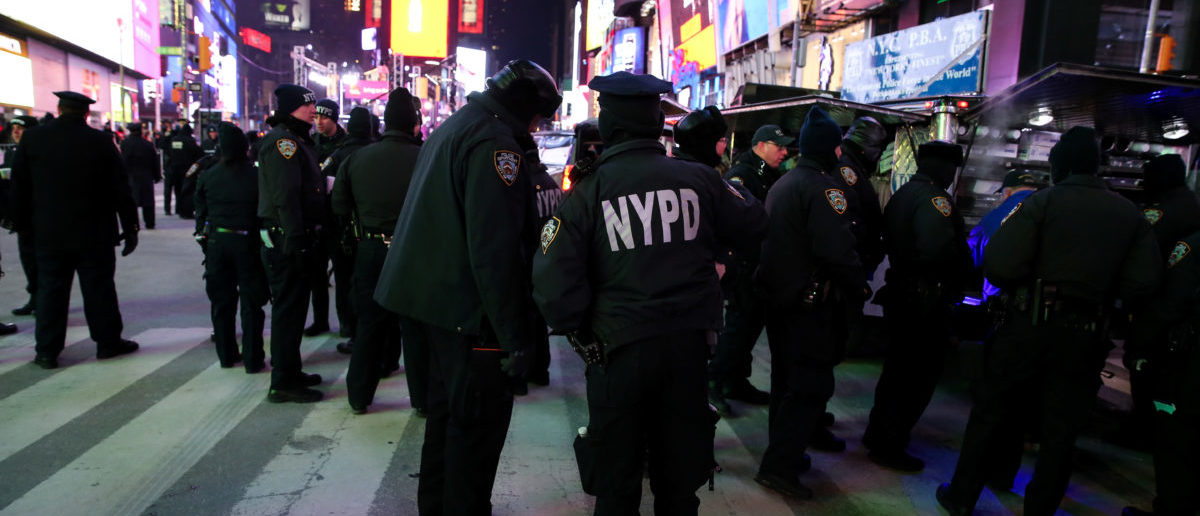 New York Police Department (NYPD) officers stand in Times Square ahead of the New Year's Eve celebrations in Manhattan, New York, U.S., December 31, 2017. REUTERS/Amr Alfiky -