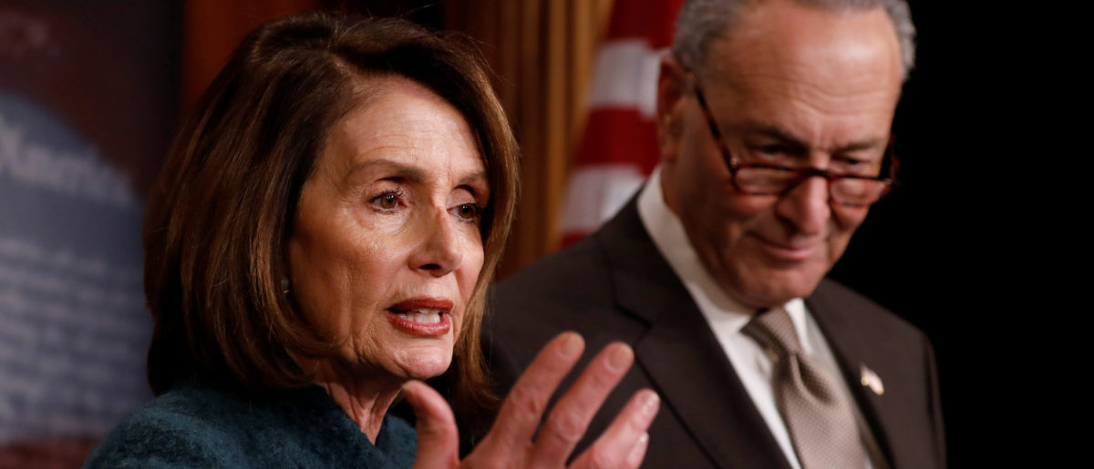 House Minority Leader Nancy Pelosi, accompanied by Senate Minority Leader Chuck Schumer, speaks at a news conference about the omnibus spending bill moving through Congress on Capitol Hill in Washington, U.S., March 22, 2018. REUTERS/Aaron P. Bernstein