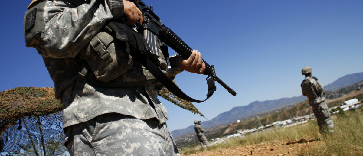 United States National Guard troops patrol along the U.S. and Mexico border in Nogales, Arizona October 8, 2010. The troops are part of a 1,200 soldier deployment authorized by President Barack Obama to patrol against illegal immigrants and drug smugglers. Arizona will receive 560 troops to protect the border. REUTERS/Joshua Lott