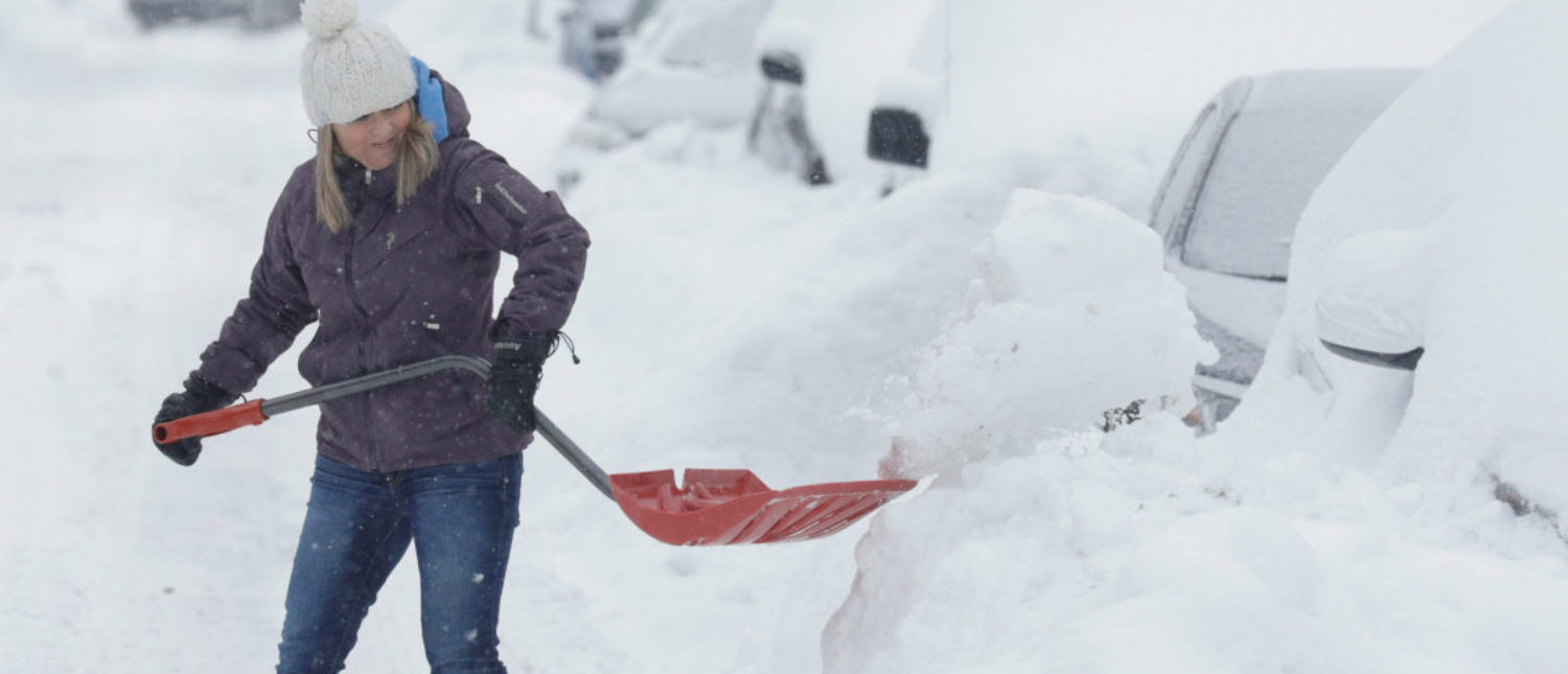 Line Dessureault shovels snow away from her car that was buried in snow as a late winter storm that dumped more than two feet (60 cm) of snow in certain areas of Quebec, closed schools and some roadways causing multiple highway collisions and incidents of trapped motorists, in Montreal, Quebec, Canada March 15, 2017. REUTERS/Dario Ayala
