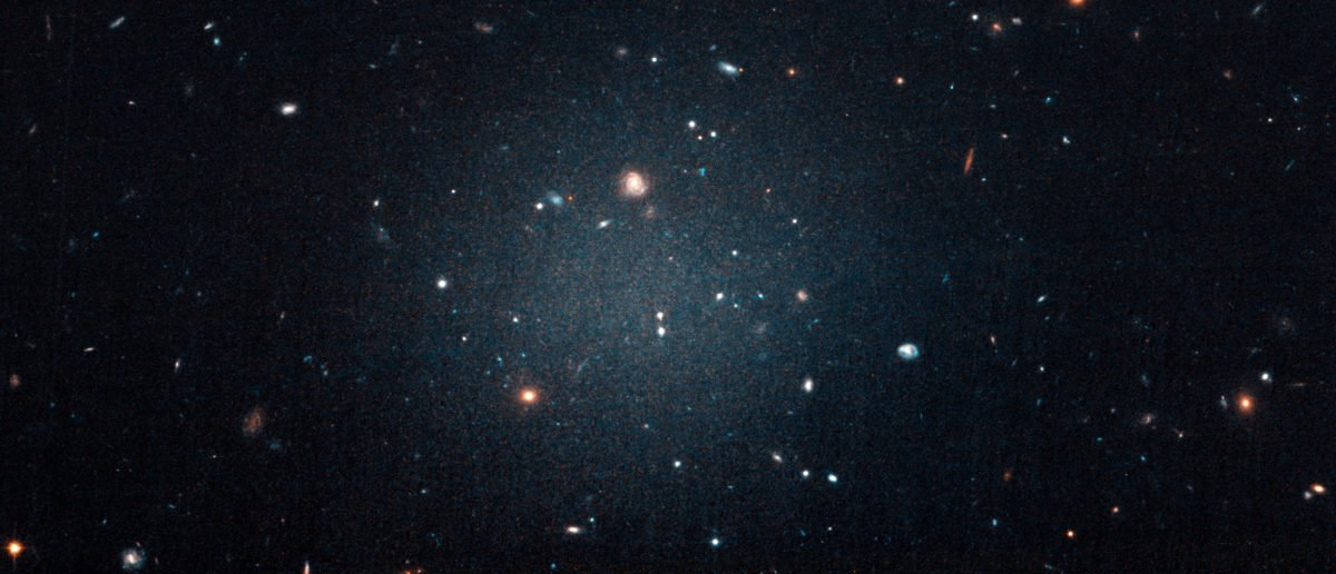 The galaxy named NGC 1052-DF2, a large fuzzy-looking galaxy so diffused that astronomers call it a 'see-through' galaxy because its missing most, if not all of its dark matter, is shown in this photo obtained from NASA on March 28, 2018. NASA, ESA, and P. van Dokkum (Yale University)/Handout via REUTERS | 'Luxury Space Hotel' Set To Open In 2022