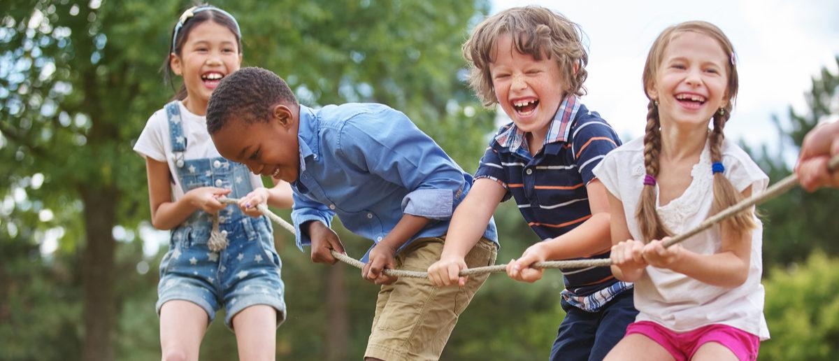 Children playing tug of war at the park Shutterstock/ Robert Kneschke   'Free-Range Parenting' Law Passed In Utah