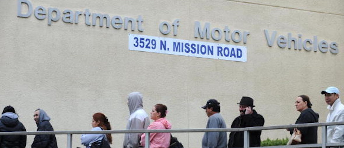 People wait in line outside of the State of California Department of Motor Vehicles (DMV) in Los Angeles, California on February 13, 2009. The DMV, already infamous for long waiting times, is now further taxed as employees are off the job and the offices are closed two days a month as California government imposes its first-ever unpaid furlough to save money during the fiscal crisis. The action is in connection with SchwarzeneggerÔøΩs executive order that addresses the stateÔøΩs 42 billion USD deficit and ongoing fiscal crisis. Schwarzenegger has also threatened to lay off as many as 10,000 state employees if a new budget is not passed this week. AFP PHOTO/ ROBYN BECK (Photo credit should read ROBYN BECK/AFP/Getty Images)