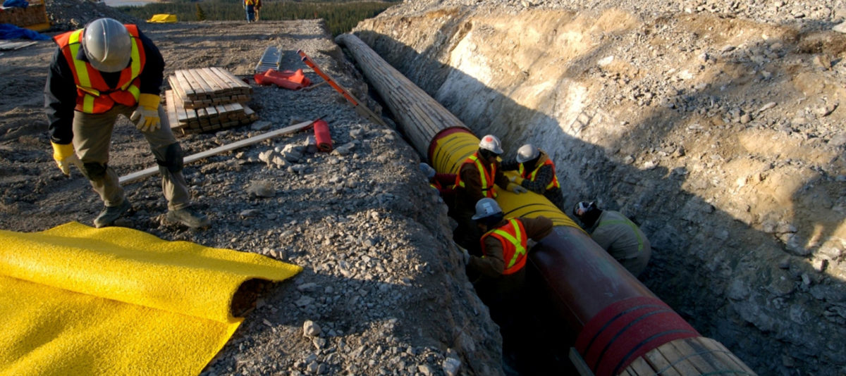 FILE PHOTO: Workers construct the Anchor Loop section of Kinder Morgan's Trans Mountain pipeline expansion in Jasper National Park in a 2009 file photo. Kinder Morgan Canada/Handout/File Photo via REUTERS | FERC Reviewing Pipeline Approval Process