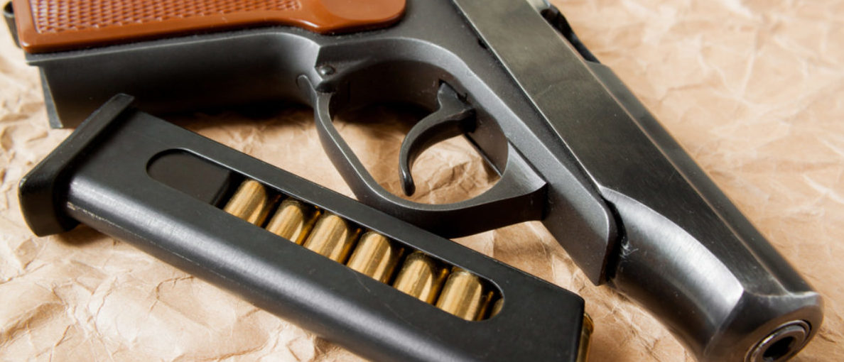 Here's a pistol with ammo. (Shutterstock/Aleksey Kuzmenko)