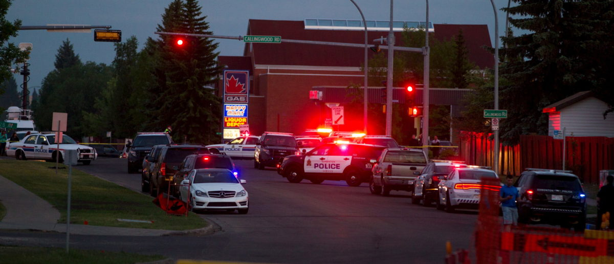 Police officers block off roads surrounding 184th Street and 62nd Avenue in southwest Edmonton, after an officer was shot at the scene on Monday, June 8, 2015. An Edmonton police officer was killed and another injured with a gunshot wound, local media reported. REUTERS/Topher Seguin