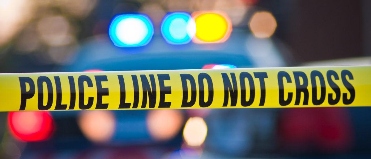 Police tape blocks off the scene of a crime.